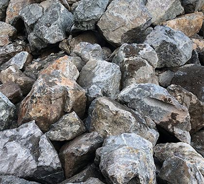 A pile of landscape rock of various sizes and shapes.