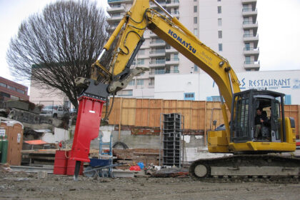 A construction site featuring heavy machinery in action.