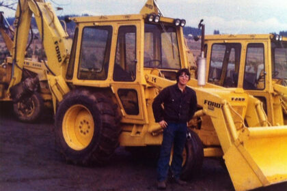 A photo of a Michell team member posing in front of equipment.